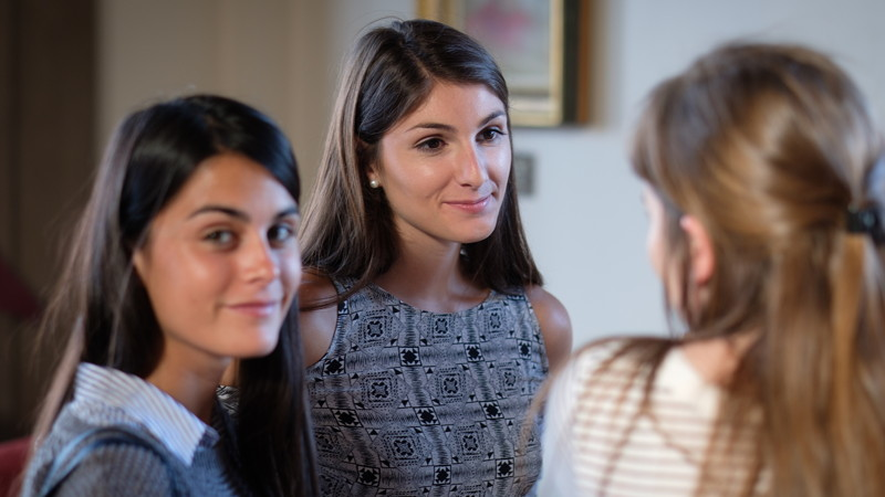 Students in conversation during welcome reception
