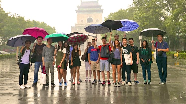 NEW Students in rain 16.9