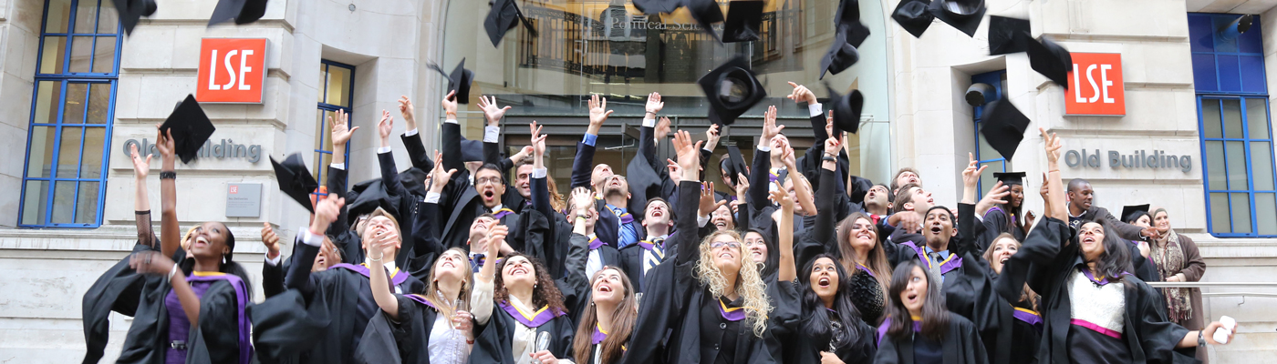 A group of LSE graduates throw their hats in the air
