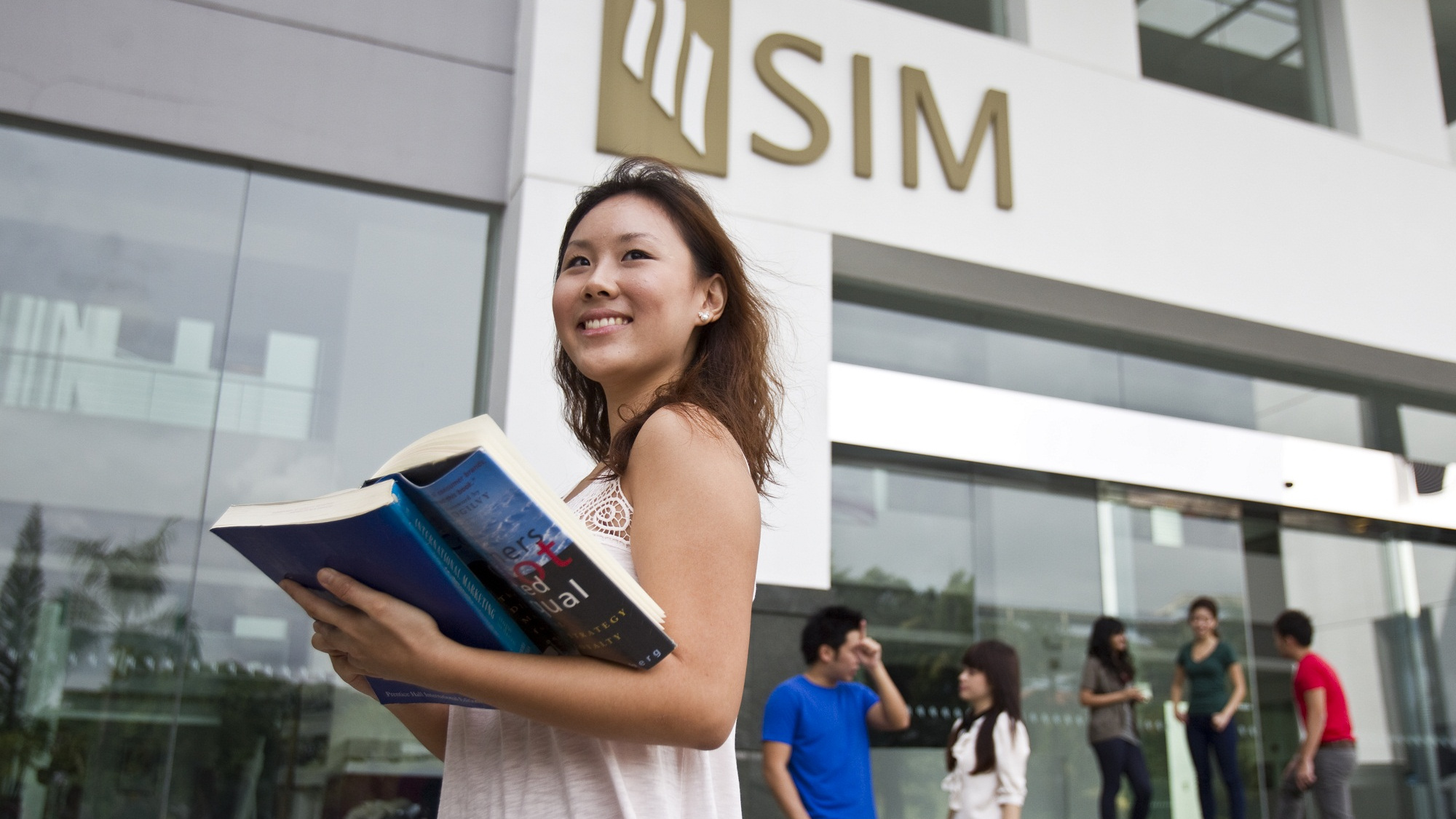 SIM student outside of her teaching institution