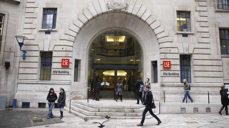 People walking past the Houghton Street entrance to LSE's Old Building