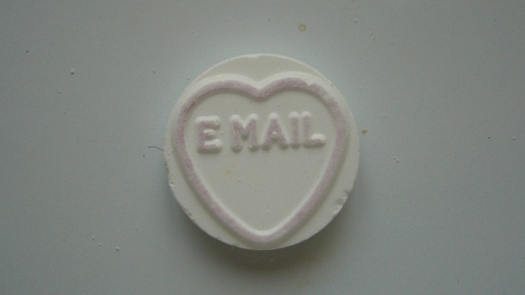 "A small candy with the word ""email"" on it"